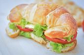 Sandwich Or Croissant Sandwich With Cheese And Ham poster