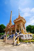 pic of crematory  - Buddhist gold crematory with blue sky Thailand - JPG