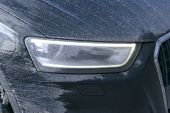 Front View Of A Very Dirty Car. Fragment Of A Dirty Suv. Dirty Headlights, Wheel And Bumper Of The O poster