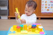 Cute Little Asian 18 Months Old Toddler Baby Boy Child Having Fun Playing Colorful Modeling Clay / P poster