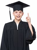 Portrait Of Graduate Teen Boy Student In Black Graduation Gown With Hat Has Idea, Pointing With Fing poster