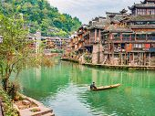Unacquainted Local Chinese People On The Boat In Fenghuang Old Town.phoenix Ancient Town Or Fenghuan poster