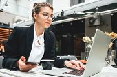 Pensive Business Woman At Cafe Veranda Using Personal Laptop For Working Digital Social Media. Hands poster