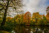Beautiful Autumn Landscape, Trees Reflected In The Water In Copenhagen Park. Denmark, Copenhagen poster