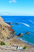 Dark Sandy Prainha Beach By The Atlantic Ocean In Madeira, Portugal. Surrounded By Volcanic Rocks An poster