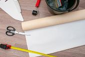 Still Life Of Rolls Of Wallpaper And Different Tools For Wallpapering. Home Repairs. poster