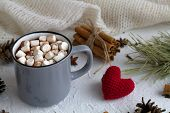 Cup Of Hot Chocolate With Marshmallows And Cinnamon, Anise Star And Knitted Red Heart On White Backg poster