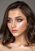 Beautiful Young Model With Colorful Trendy Smoky Eyes, Bright Blue Eyes And Natural Hairdo poster