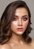 A Very Beautiful Young Girl With Colorful Trendy Smoky Eyes, Bright Blue Eyes And Natural Wavy Haird poster