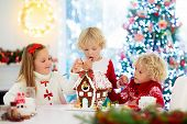 Kids Baking Gingerbread House. Christmas At Home. poster