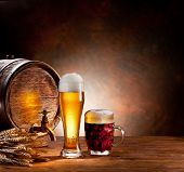 pic of beaker  - Beer barrel with beer glasses on a wooden table - JPG