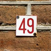 picture of formica  - small house number forty nine red lettering engraved in Formica - JPG