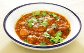foto of stew  - A Moroccan chicken tagine cooked with tomatoes - JPG
