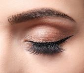 Young woman with elegant makeup and long eyelashes, closeup. Eyelash extensions poster