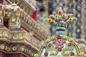 thai religious ceramics ornament in wat phra kaeo temple, Bangkok, Thailand