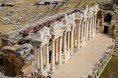 Columns On The Stage Of The Amphitheater. Ancient Antique Amphitheater In The City Of Hierapolis In  poster