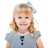 Little blond girl smiling isolated on white background