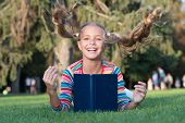 Getting Your Hairstyle Fly. Happy Child With Flying Hairstyle On Green Grass. Small Cute Girl Smile  poster