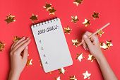 Womans Hands Holding Pencil Near The Notepad With Text 2020 Goals poster