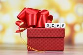 Give Gift Concept / Giving A Gift Box Present Wrapped With Red Ribbon For Christmas Time Holiday Or  poster