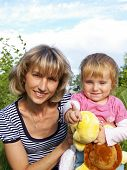 picture of niece  - Young beautiful woman and her small niece with a toy - JPG