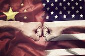 Trade War Between Usa And China Concept. Two Clenched Fists Punch Each Other On Usa And China Flag B poster