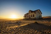 Sunrise Above An Abandoned House In Kolmanskop Ghost Town Located In Southern Namibia Near The Town  poster
