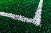 Green Football Field Closeup. White Marking Line On A Soccer Field. New Artificial Turf. Before The  poster