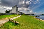 Ross Castle with empty bench near Killarney, Co. Kerry Ireland