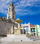The San Francisco Square and the church with the same name in Old Havana , a touristic landmark famous for its traditional architecture and its cultural importance in Old Havana poster