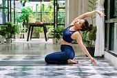 Activity Young Women Wear Blue Sportswear Doing Position Detox Yoga Sequence On The Mat. Relaxation  poster