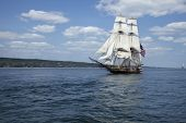 pic of brigantine  - A tall ship known as a brigantine sails on blue water - JPG