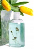 Bottle soap and heather with yellow tulips