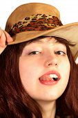 Young Woman In Hat Shows Tongue