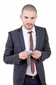 young businessman with money, isolated white background