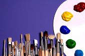stock photo of paint brush  - painters white pallette and paints with painters brushes - JPG