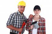 Tradespeople holding tools