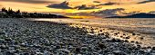 Panoramic Pebble Beach With Orange Sunset