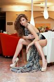 picture of leggy  - Leggy beautiful young woman in a restaurant - JPG