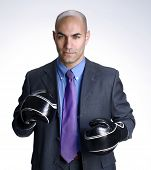 Bald head businessman using boxing gloves.