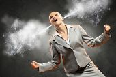 businesswoman in anger screaming steam going out from ears
