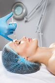 pic of lip augmentation  - Young woman receiving a botox injection in her front - JPG