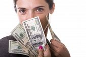 pic of young adult  - businesswoman showing her money from a jackpot - JPG