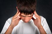 Young Man Feels Headache