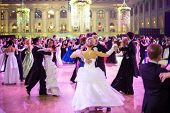 MOSCOW - MAY 25: Couples whirling in the dance under purple lights  at 11th Viennese Ball in Gostiny Dvor on May 25, 2013 in Moscow, Russia.