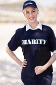 pretty charity volunteer on street looking at the camera