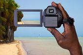 Video camera  recording tropical  beach