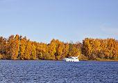 Motorboat On An Autumn Lake