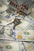 Small Model House and Keys on Newly Designed U.S. One Hundred Dollar Bills.