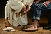 Jesus washing feet of modern man wearing jeans